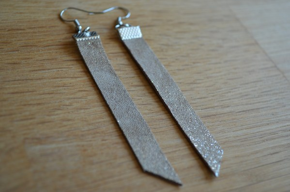Long drop sparkly gold leather earrings