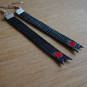 Long black drop earrings with red circles