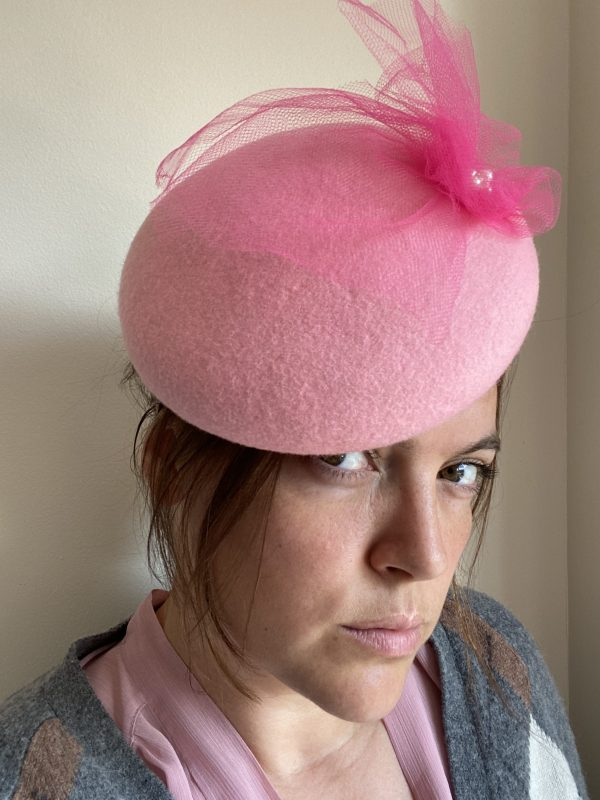 Pink button hat with netting