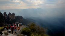 Smoke is seen as a fire continues to burn in Katoomba, Blue Mountains. Picture: AAP