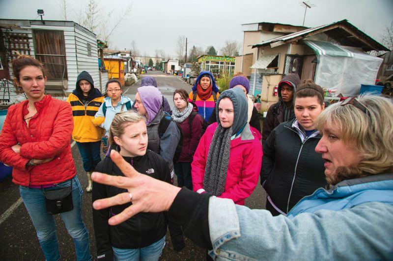 PAMPLIN MEDIA PHOTO: CHRISOPHER ONSTOTT - Lisa Larson, who calls herself the 'vice chief executive officer' of Dignity Village gave a group of University of Portland students a tour of the Northeast Portland homeless camp for their urban poverty immersion experience in 2013.