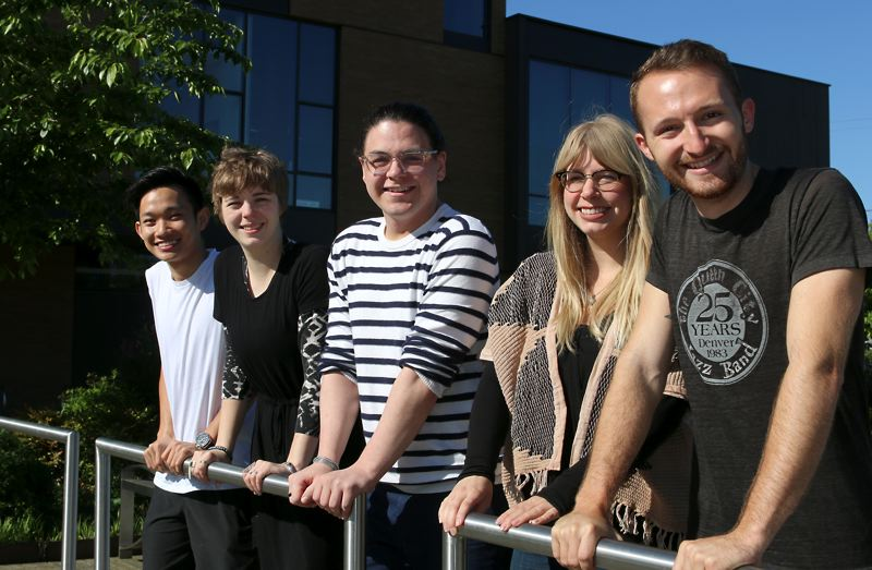 COURTESY PCC - Student Alex Bell-Johnson, far right, and Sustainability Manager Briar Schoon, second from right, led the divestment effort. From left, students who also made a difference include Kien Truong, Molly Walker and Sebastian Scholene.