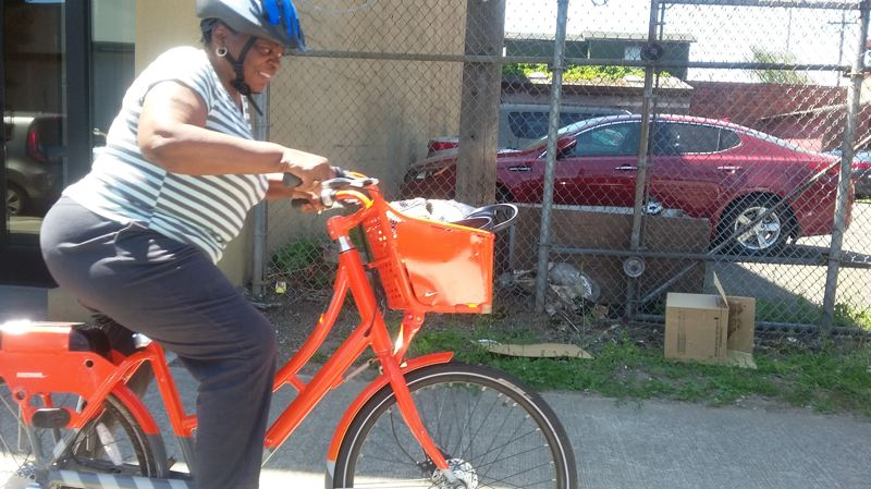 PAMPLIN MEDIA GROUP: OLIVIA SANCHEZ - Dolores Griggs tries out a rental bike after taking a workshop offered by Biketown for All. The program aims to improve access for lower-income riders.