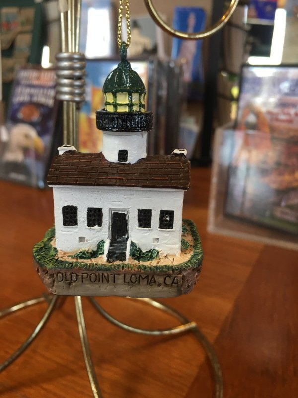 A hand sized lighthouse replica ornament