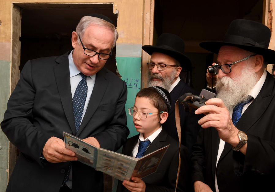 Prime Minister Benjamin Netanyahu and Moshe Holtzberg at the Chabad House in Mumbai on January 18th, 2018. (Credit: Avi Ohayon- GPO)