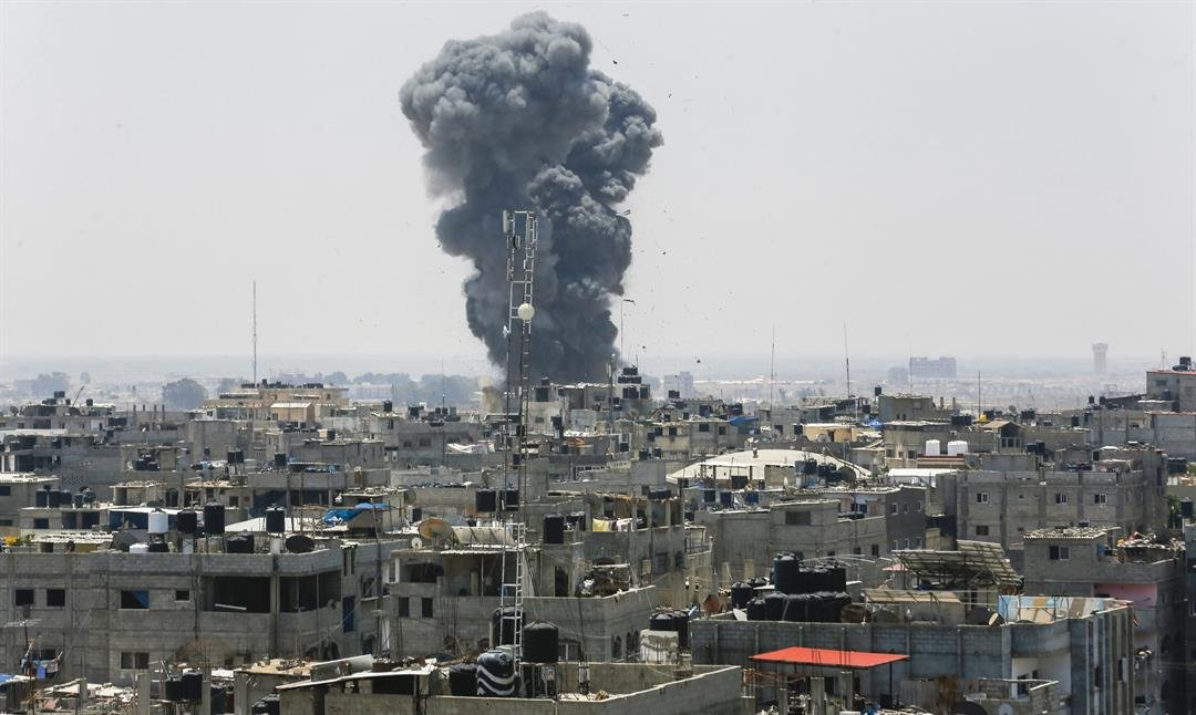A plume of smoke rises Saturday after an Israeli airstrike in Rafah in southern Gaza.