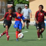 Young footballers entertain with hard-fought matches
