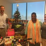 Law firm donates gifts to foster home