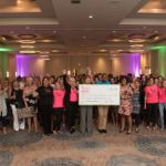 100 Women Who Care donate $24K to AIDS Foundation
