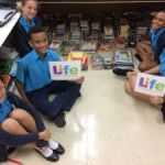 Cayman Prep donates books to LIFE