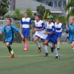 Cayman Prep footballers take girls opening rally