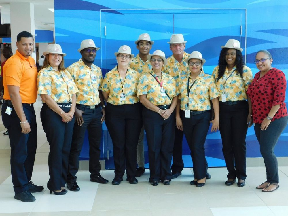 Customer service officer Arvin Haylock (left) and customer service manager Ivis Matute (right) flank new ambassadors Cheryl-Lynn Ebanks, Peter Gore, Marjorie Stewart, Jonathan Anderson, Eilene Sutton, Adrian Barnett, Jessy King and Demesha Bodden (not in photo: Carlene Leachman)