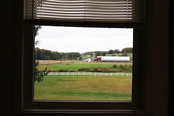 A farm is visible from a classroom window within Swan Meadow School in Oakland, Md., on Wednesday, October 5, 2016. The school serves an agrarian community and has Amish and Mennonite students. (Vickie Connor/Capital News Service)
