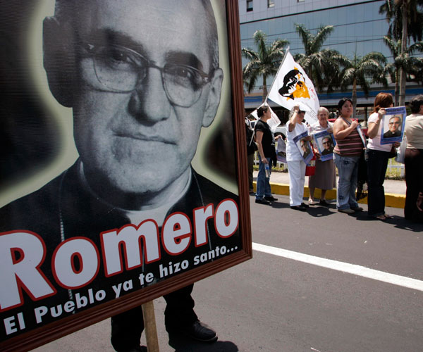 Salvadorans honor the late Archbishop Oscar Romero in San Salvador on the anniversary of his assassination in 2009.  (CNS file/Reuters)