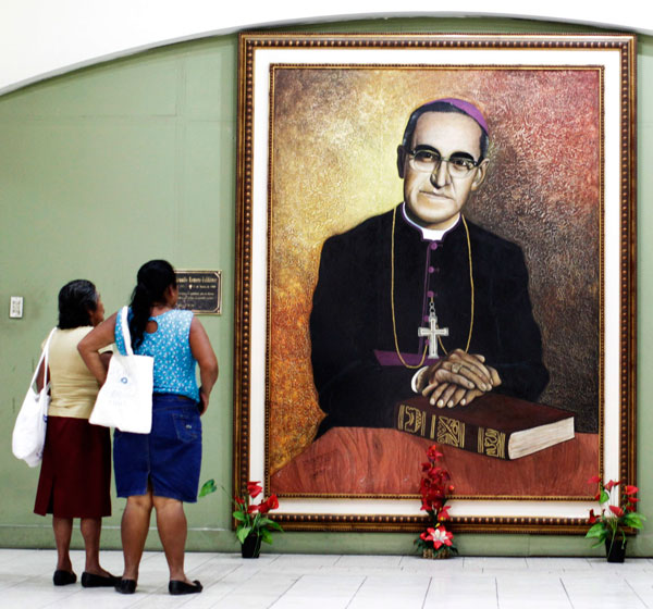 People look at a painting of slain Salvadoran Archbishop Oscar Romero at the cathedral in San Salvador Feb. 3 after Pope Francis signed a decree recognizing his martyrdom. (CNS/Reuters)