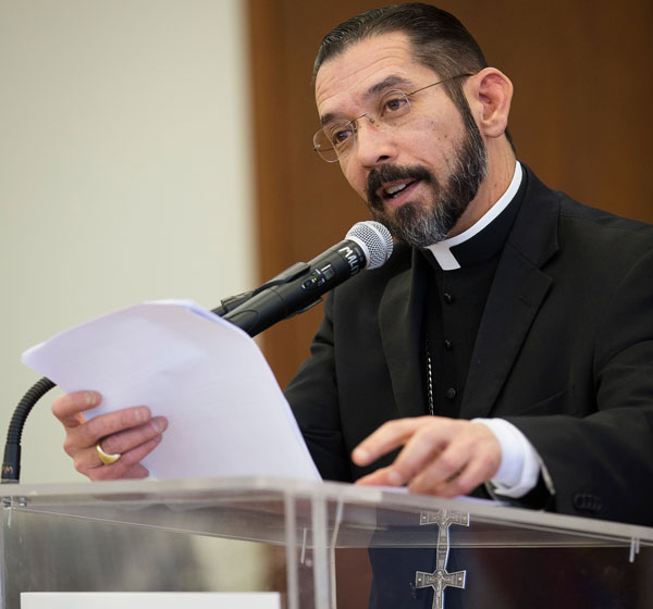 Bishop Daniel E. Flores of Brownsville, Texas, delivers a lecture on immigration Feb. 24 on the campus of The Catholic University of America in Washington. (CNS/Tyler Orsburn)