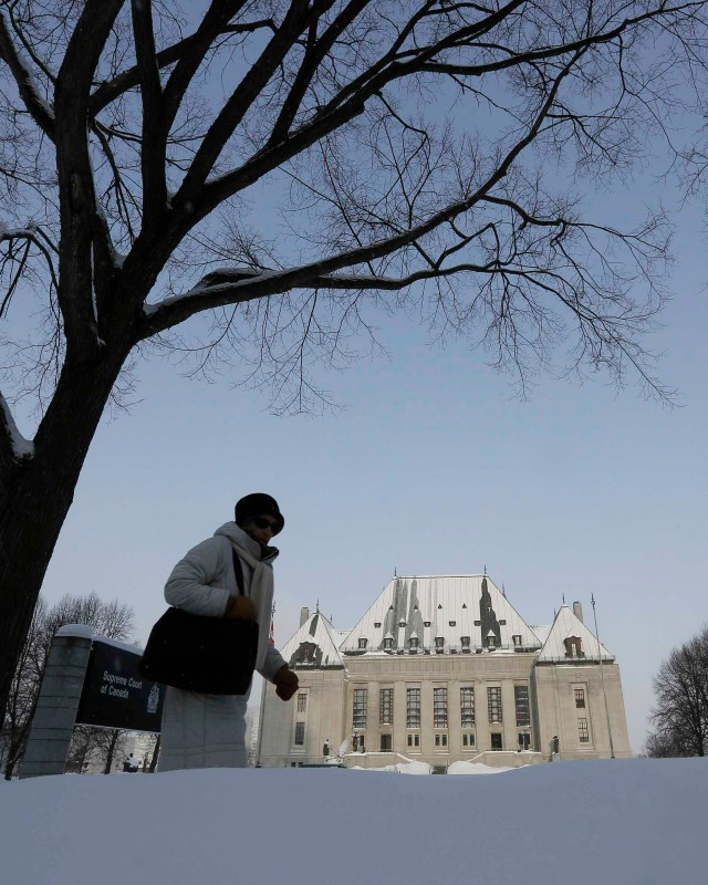 A woman walks past the Supreme Court of Canada in Ottawa Feb. 6. The same day, the court  overturned a 1993 ban against assisted suicide. (CNS/Reuters)