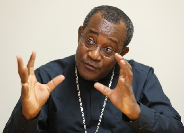 Bishop Launay Saturne of Jacmel gestures during an interview with Catholic News Service. (CNS/Bob Roller)