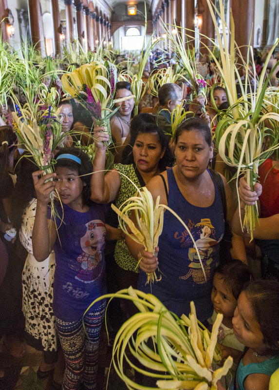 Parishioners at St. Lucy Parish in Suchitoto, El Salvador, wait to have their palms blessed during a Palm Sunday Mass March 29. (CNS photo/Octavio Duran)
