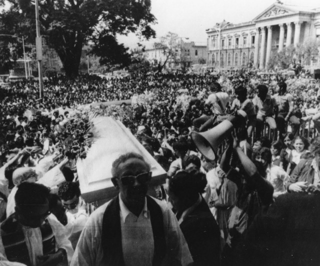 Thousands gather outside the Metropolitan Cathedral in San Salvador March 30, 1980, as the casket of slain Archbishop Oscar Romero is carried inside for a funeral Mass. (Scan of CNS file photo)