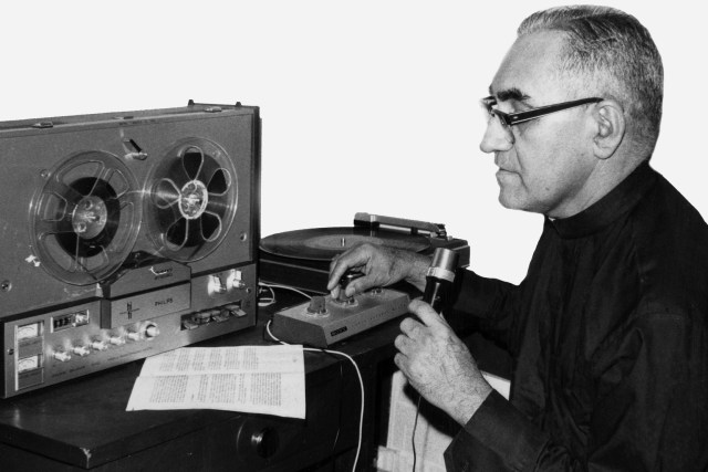 "Archbishop Oscar Romero of San Salvador is seen in an undated photo working in an improvised radio studio in Salvadoran capital. Pope Francis formally recognized that Archbishop Romero was killed ""in hatred of the faith,"" clearing the way for his beatification. (CNS/Octavio Duran)"
