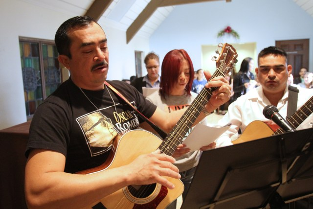 Musicians lead the congregation March 22 at Our Lady of the Miraculous Medal Church in Wyandanch, N.Y, during a Spanish-language Mass to mark the 35th anniversary of Salvadoran Archbishop Oscar Romero's assassination. (CNS/Gregory A. Shemitz)