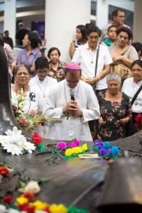 Auxiliary Bishop Gregorio Rosa Chavez of San Salvador prays March 22 before the tomb of Archbishop Oscar Romero to mark the 35th anniversary of his death in San Salvador. (CNS/ Octavio Duran)