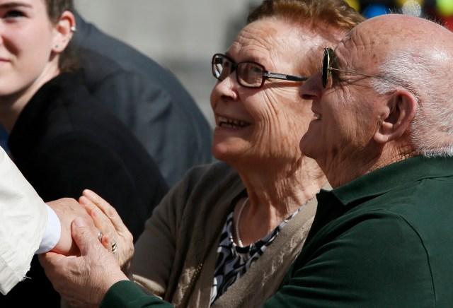 Pope Francis greets older people while meeting the disabled at his general audience in St. Peter's Square April 1. (CNS photo/Paul Haring)