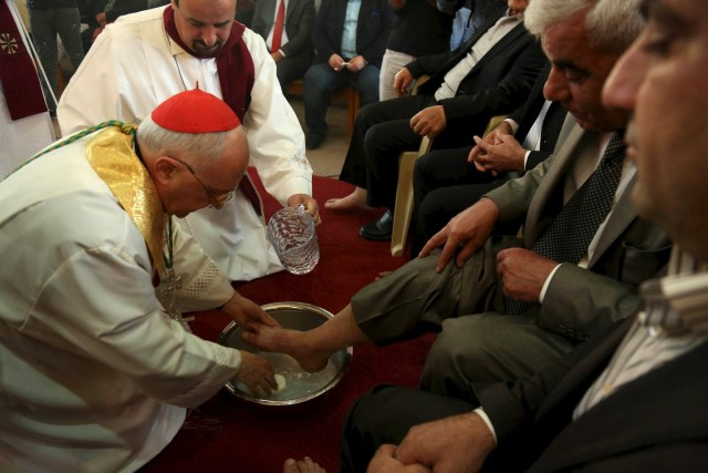 Cardinal Fernando Filoni, prefect of the Congregation for the Evangelization of Peoples, washes the feet of displaced Iraqi Christians from Mosul in Dohuk, northern Iraq, on Holy Thursday, April 2. (CNS/Reuters)