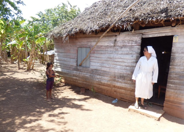 Sister Olga Arias visits a family of nine, including seven children, in early March in rural Cuba. It can be daunting to transmit the values of the church when families are focused on day-by-day survival, she said. (CNS/Rhina Guidos)