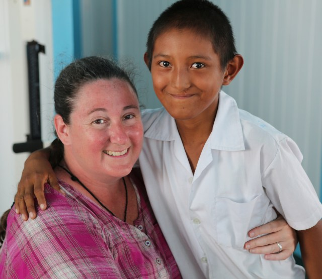 Mercy Sister Karen Schneider, assistant professor of pediatric emergency medicine at Johns Hopkins University in Baltimore, poses with a former cleft lip patient at a clinic in Guyana. (CNS/Bob Roller)