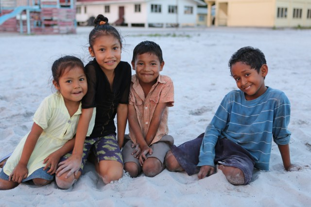 Children pose outside a primary school in the village of Wakapoa along the Pomeroon River in Guyana.  (CNS/Bob Roller)