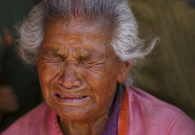 A woman mourns the death of her granddaughter April 27 following an earthquake in Nepal. (CNS/Reuters)