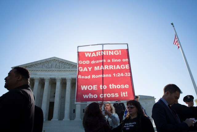 A woman opposing same-sex marriage stands outside the U.S. Supreme Court in Washington April 28. (CNS/Tyler Orsburn)