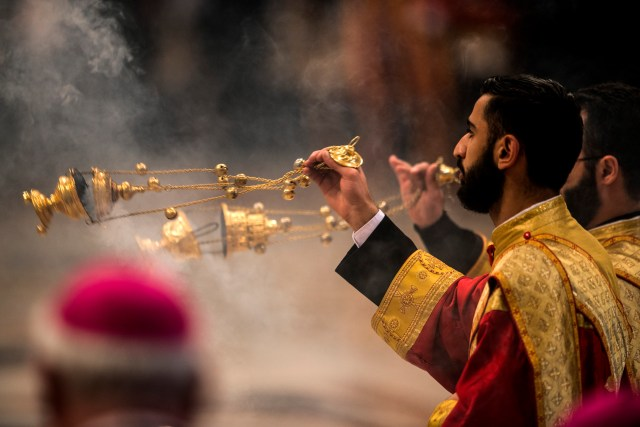 Servers use incense as Pope Francis celebrates an April 12 Mass in St. Peter's Basilica at the Vatican that marked the 100th anniversary of the mass killings of Armenians.  (CNS/Cristian Gennari)