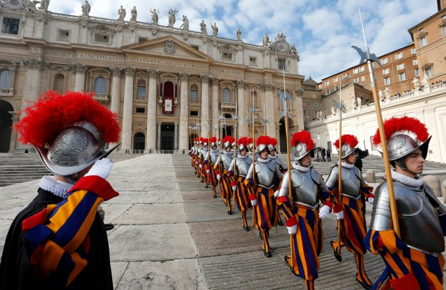 Swiss Guard march after an event with Pope Francis in St. Peter's Square. (CNS/Paul Haring)