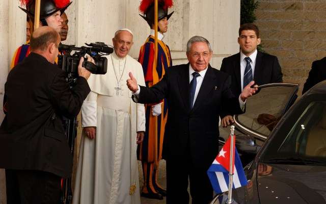 Cuban President Raul Castro gestures toward media as he leaves a private meeting with Pope Francis in the pope's studio in Paul VI hall at the Vatican May 10. (CNS/Paul Haring)