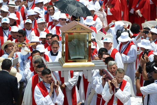 Priests carry the blood-stained shirt of Archbishop Oscar Romero during his beatification Mass in San Salvador May 23. (CNS/Lissette Lemus)