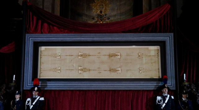 The Shroud of Turin is displayed during a preview for journalists at the Cathedral of St. John the Baptist in Turin, Italy, April 18. A public exposition of the shroud, believed by many to be the burial cloth of Jesus, runs from April 19 through June 24. (CNS/Paul Haring)