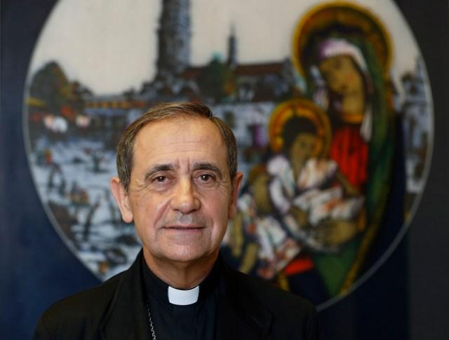 """Bishop Juan Ignacio Arrieta, secretary of the Pontifical Council for Legislative Texts, is pictured in his office at the Vatican. Bishop Arrieta explained why Pope Francis is appointing """"missionaries of mercy"""" to preach and teach during the Holy Year of Mercy, which opens Dec. 8 and runs until Nov. 20, 2016. (CNS/Paul Haring)"""