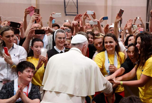 Pope Francis greets young people during a meeting with them at the diocesan St. John Paul II Center in Sarajevo June 6. (CNS/Paul Haring)