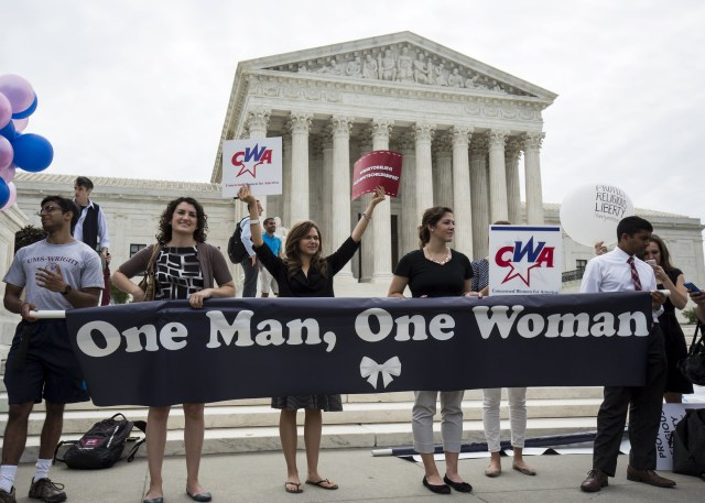 Supporters of traditional marriage between a man and a woman rally in front of the U.S. Supreme Court in Washington June 26, shortly before the justices handed down a 5-4 ruling that states must license same-sex marriages and must recognize same-sex marriages performed in other states. (CNS/Reuters)