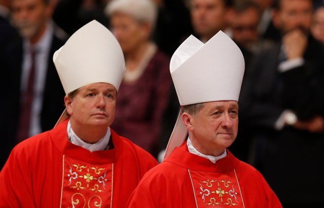 Archbishops Anthony Fisher of Sydney and Blase J. Cupich of Chicago leave after attending Pope Francis' celebration of Mass marking the feast of Sts. Peter and Paul in St. Peter's Basilica at the Vatican June 29.  (CNS photo/Paul Haring)
