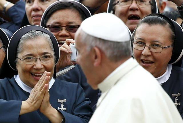 Nuns greet Pope Francis as he arrives to lead his weekly general audience in St. Peter's Square at the Vatican June 24. (CNS/Reuters)