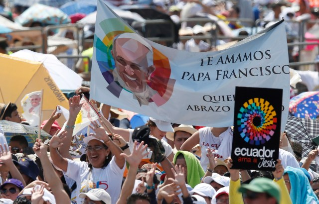 People wait for Pope Francis' arrival to celebrate Mass in Samanes Park in Guayaquil, Ecuador, July 6. (CNS photo/Paul Haring)