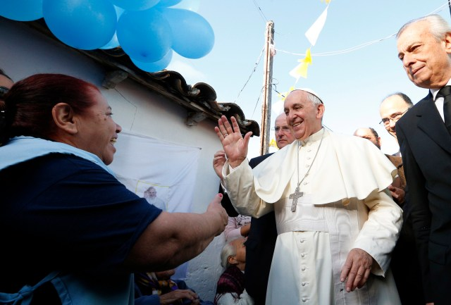Pope Francis meets with people of  Banado Norte, a poor neighborhood in Asuncion, Paraguay, July 12. The visit was an example of the pope's insistence on meeting with disadvantaged peoples.  (CNS/Paul Haring)