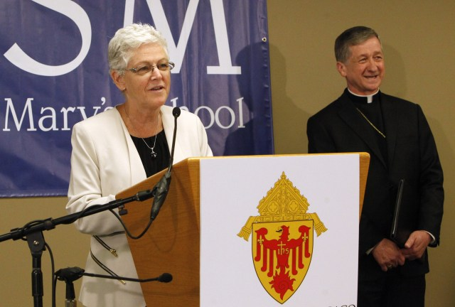 Gina McCarthy, administrator of the U.S. Environmental Protection Agency, addresses the media alongside Archbishop Blase J. Cupich of Chicago July 24 after touring Old St. Mary's School in Chicago. (CNS/Karen Callaway, Catholic New World)