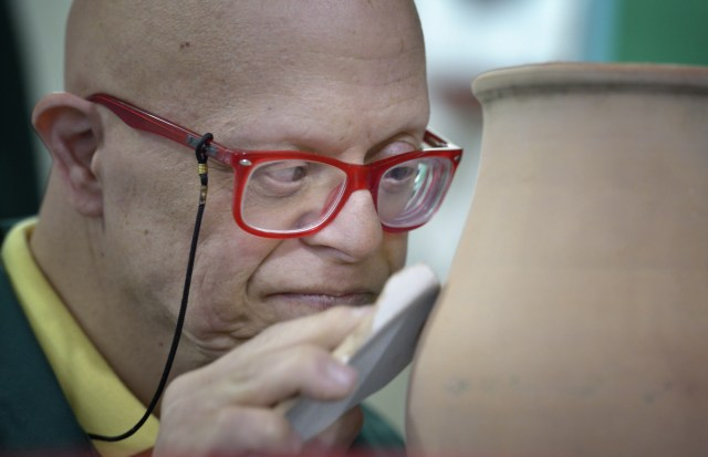 Naji smoothes pottery in late May at Phenix Group Homes, an organization in Beirut that provides residential and day care for people living with intellectual disabilities. (CNS/Paul Jeffrey)