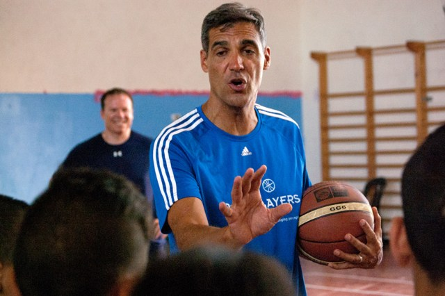 Villanova University Coach Jay Wright gives pointers to Arab and Israeli youth during a July 30 basketball clinic sponsored by PeacePlayers International in Jerusalem. The clinic was followed by a game with Arab, Israeli and American youth participating. (CNS/Mary Knight)