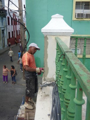 A worker fixes up a corner of the Cathedral of Our Lady of the Assumption in early March in Santiago de Cuba, the island's second-largest city. (CNS/Rhina Guidos)